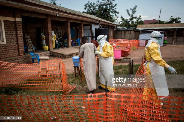 Medical workers lead a man with suspected Ebola into the unconfirmed Ebola patients ward run by The Alliance for International Medical Action on...