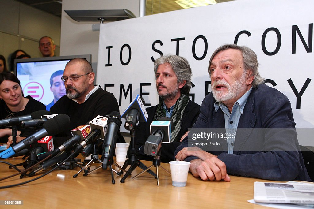 Medical workers Matteo Dell'Aira (C) and Marco Garatti (L) attend a press conference with Gino Strada, founder of Italian aid agency Emergency, at the agency's headquarters on April 23, 2010 in Milan, Italy. Matteo Dell'Aira, Marco Garatti and Matteo Pagani, all employees of Emergency, were released after being held for a week by Afghan authorities over an alleged assassination plot against the governor of Helmand province.