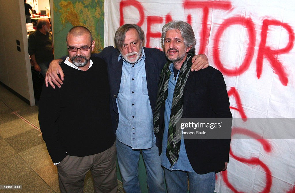 Medical workers Matteo Dell'Aira (R) and Marco Garatti (L) pose for photographs with Gino Strada, founder of Italian aid agency Emergency, at the agency's headquarters on April 23, 2010 in Milan, Italy. Matteo Dell'Aira, Marco Garatti and Matteo Pagani, all employees of Emergency, were released after being held for a week by Afghan authorities over an alleged assassination plot against the governor of Helmand province.