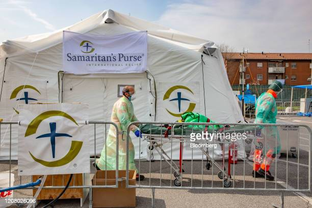 Medical workers move a patient trolley after leaving a patient at a field hospital run by nongovernmental organisation Samaritan's Purse outside of...
