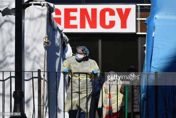 Medical workers outside at Elmhurst Hospital Center in the Queens borough of New York City on March 26 2020 Elmhurst reported 13 COVID19 patients...