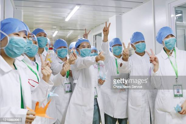 Medical workers pose for photos at 'Clean Zone' which does not receive patients in Xiaotangshan Hospital on March 30 2020 in Beijing China...