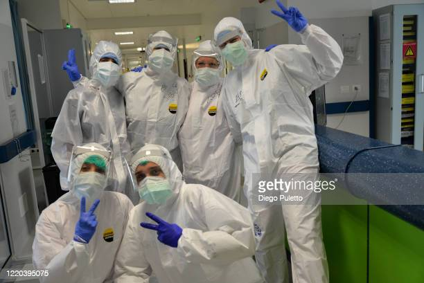 Medical workers pose in an intensive care unit in the Covid department of Turin San Luigi Hospital on April 22 in Turin, Italy. The Italian...