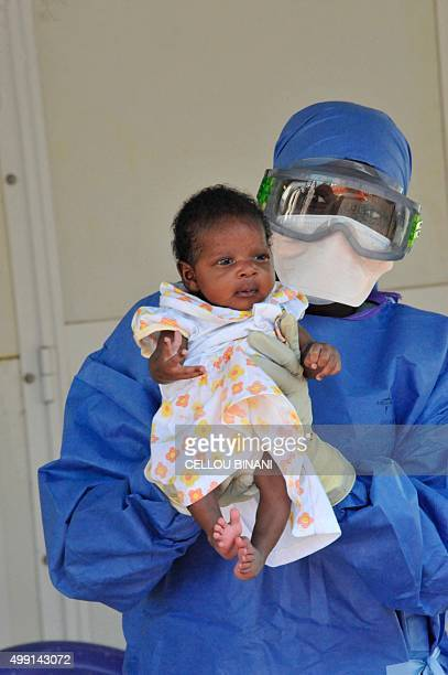 Medical workers present Noubia the last known patient to contract Ebola in Guinea during her release from a Doctors Without Borders treatment center...