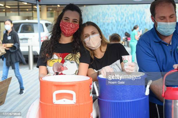 Medical workers serve Rita's Italian Ice to medical workers outside NYU Langone Health hospital during the coronavirus pandemic on May 3 2020 in New...