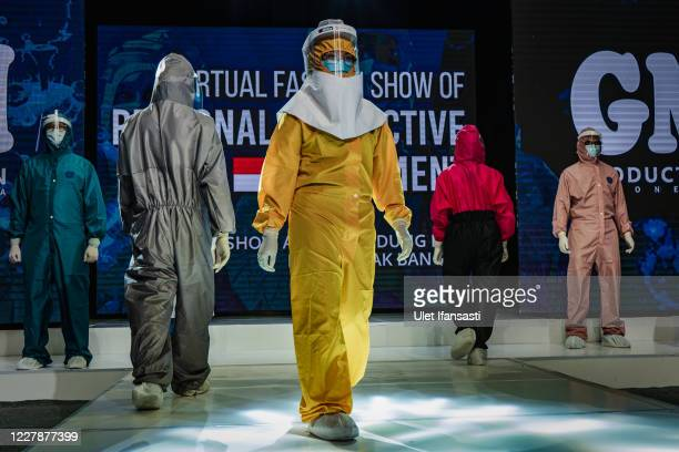 Medical workers showcase designs during the virtual fashion show of personal protective equipment amid the Coronavirus pandemic on August 1, 2020 in...