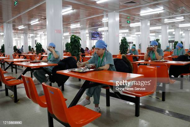 Medical workers sit separately as they have lunch at Xiaotangshan Hospital on March 30 2020 in Beijing China Xiaotangshan Hospital which was built to...