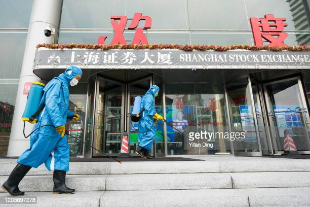 Medical workers spray antiseptic outside of the main gate of Shanghai Stock Exchange Building on February 03, 2020 in Shanghai, China.