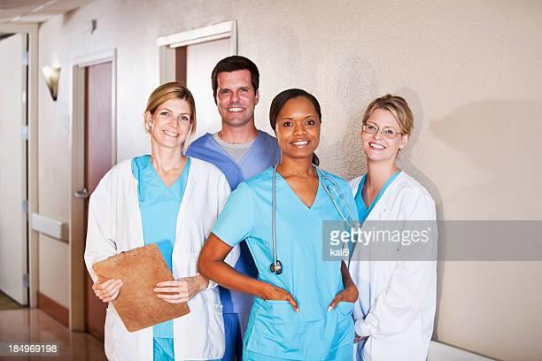 Medical workers standing in hospital corridor