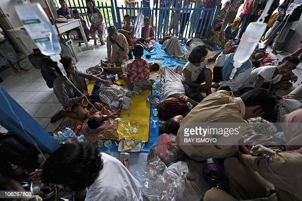 Medical workers take care of wounded victims from the village of Munte BaruBaru hamlet on North Pagai island after a 77magnitude quaketriggered...