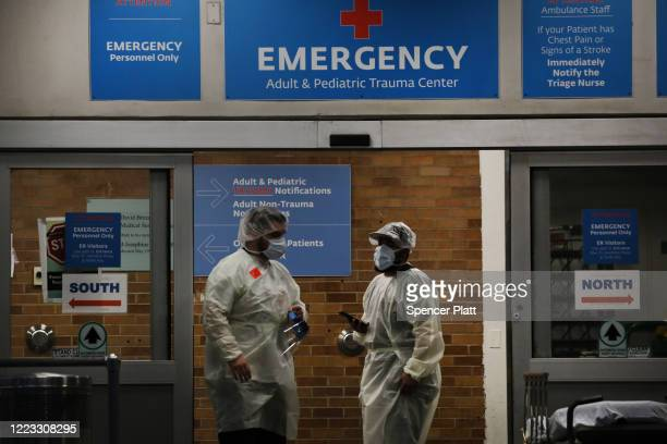Medical workers take in patients outside a special coronavirus area at Maimonides Medical Center on May 06 2020 in the Borough Park neighborhood of...