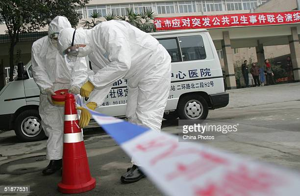 Medical workers take part in a medical drill to deal with a Severe Acute Respiratory Syndrome case at a hospital at a hospital December 18 2004 in...