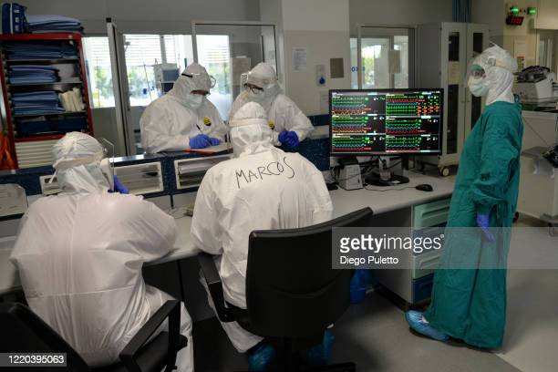 Medical workers talk with each other in an intensive care unit in the Covid department of Turin San Luigi Hospital on April 22 in Turin Italy The...
