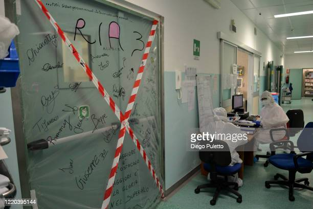 Medical workers talk with each other in an intensive care unit in the Covid department of Turin San Luigi Hospital on April 22 in Turin, Italy. The...