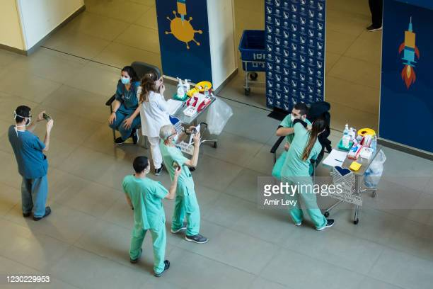 Medical workers vaccinate medical staff members against coronavirus at Tel Aviv Sourasky Medical Center as Israel starts its COVID-19 vaccination...