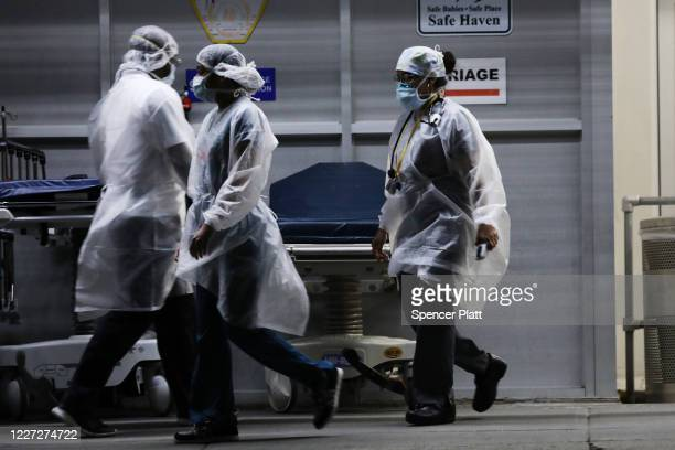 Medical workers walk outside a special coronavirus area at Maimonides Medical Center on May 26 2020 in the Borough Park neighborhood of the Brooklyn...