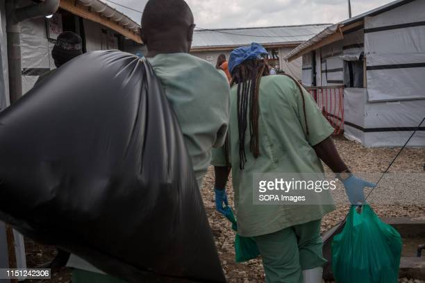 Medical workers walk through the Ebola treatment centre in Beni eastern Democratic Republic of the Congo The DRC is currently experiencing the second...