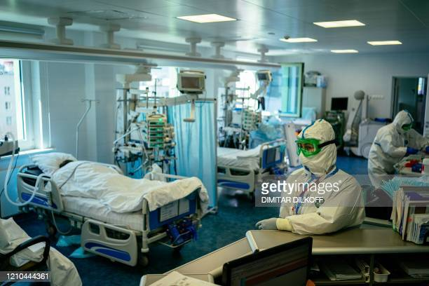 Medical workers wearing protective equipment treat patients infected with the COVID-19 coronavirus at the intensive care ward of Moscow's K+31...
