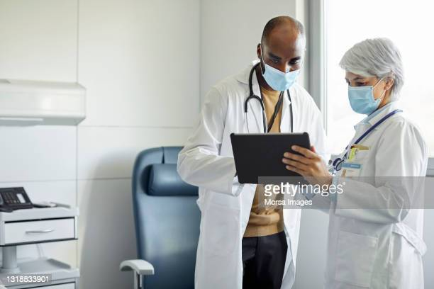 medical workers with digital tablet in hospital - healthcare stock pictures, royalty-free photos & images