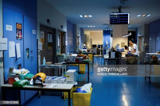 Medical workers work on March 27 at the unit for coronavirus COVID19 infected patients at the Erasme Hospital in Brussels