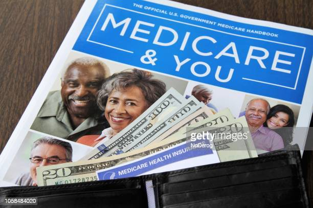 medicare and social security cards with cash and medicare handbook - medicare stock pictures, royalty-free photos & images
