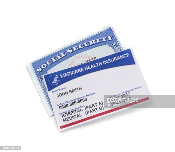 medicare health insurance card and social security card: white background - medicare stock pictures, royalty-free photos & images