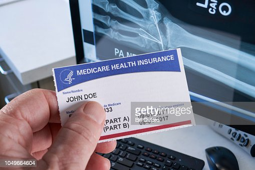 Medicare Health Insurance Card With Xray Wrist In Doctors ...