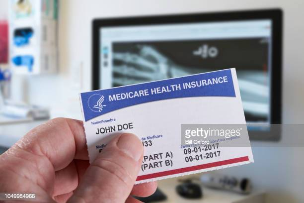 Medicare Health Insurance Card with Xray wrist in doctor's office