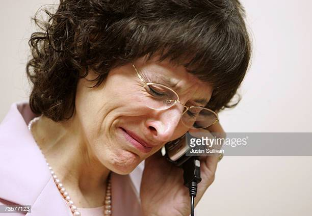 Medicinal marijuana patient Angel Raich cries as she talks on her cell phone before a press conference March 14 2007 in Oakland California The 9th...