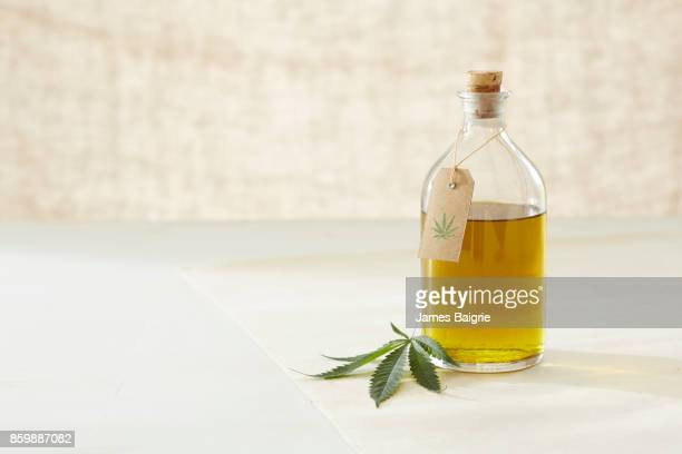 medicinal oil made from cannabis - cannabis plant stock photos and pictures