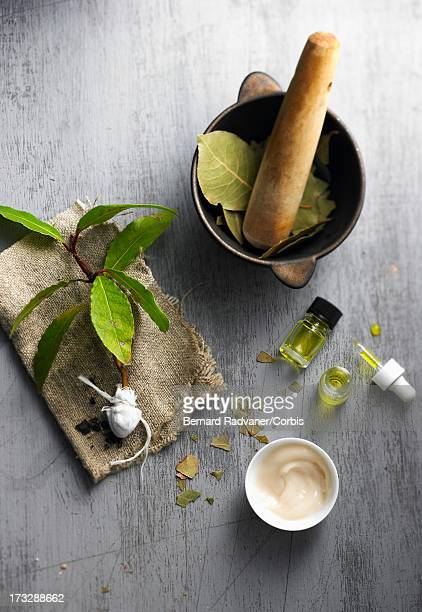 medicinal preparation with bay leaves - body care and beauty stock pictures, royalty-free photos & images