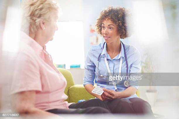 gp medicine advice - rolled up sleeves stock photos and pictures