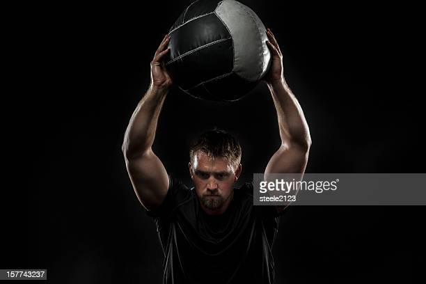 medicine ball squat - medicine ball stock pictures, royalty-free photos & images