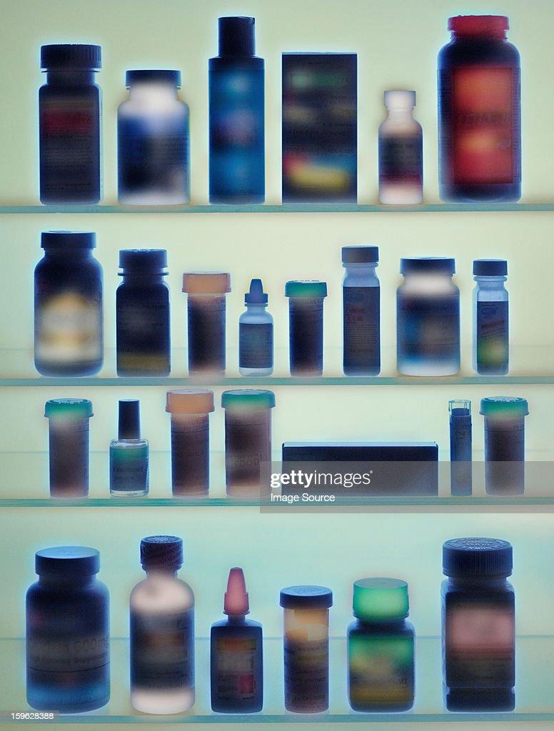 Medicine bottles in cabinet : Stock Photo