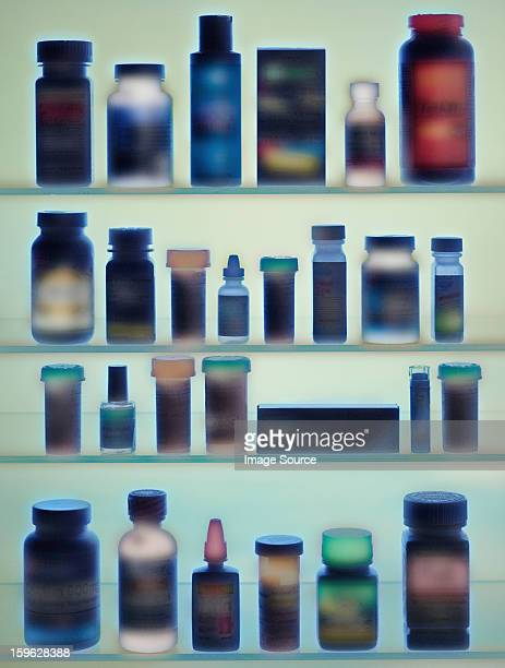 medicine bottles in cabinet - medicine cabinet stock pictures, royalty-free photos & images