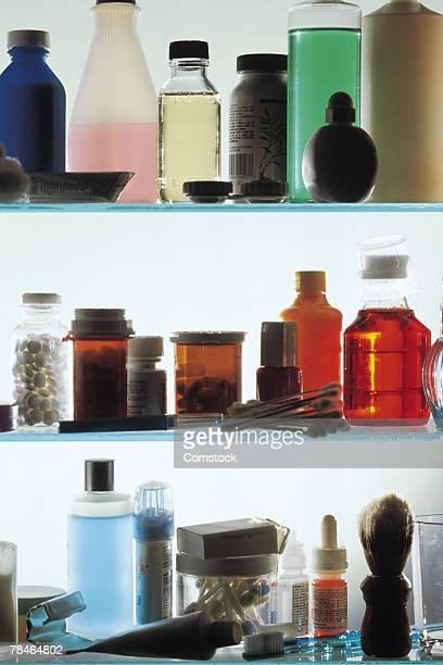 medicine bottles on shelves in vanity - armoire de toilette photos et images de collection