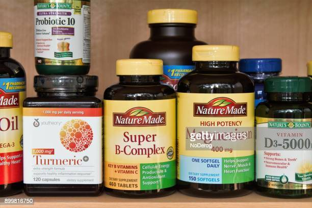 Medicine cabinet shelf with variety of vitamins and nutritional supplements