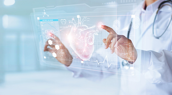 Medicine doctor and stethoscope touching icon heart and diagnostics analysis medical on modern virtual screen interface network connection. Medical technology diagnostics of heart concept 973136992