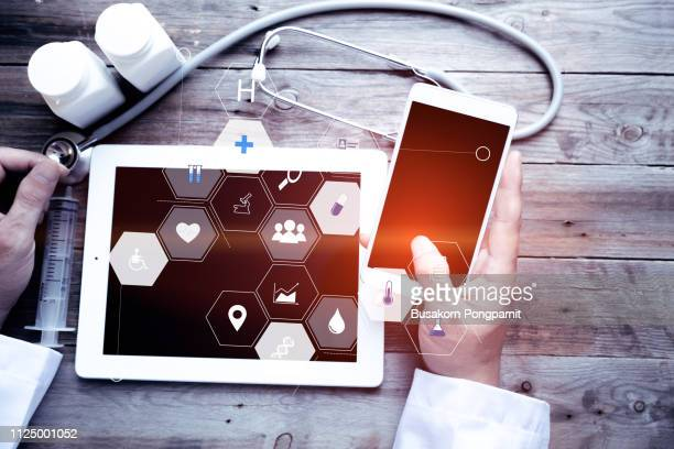 medicine doctor hand working with modern computer interface as medical network concept - digital health stock pictures, royalty-free photos & images
