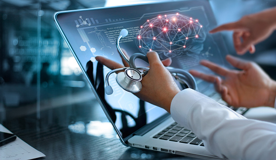 Medicine doctor team meeting and analysis. Diagnose checking brain testing result with modern virtual screen interface on laptop with stethoscope in hand, Medical technology network connection concept. 962094986