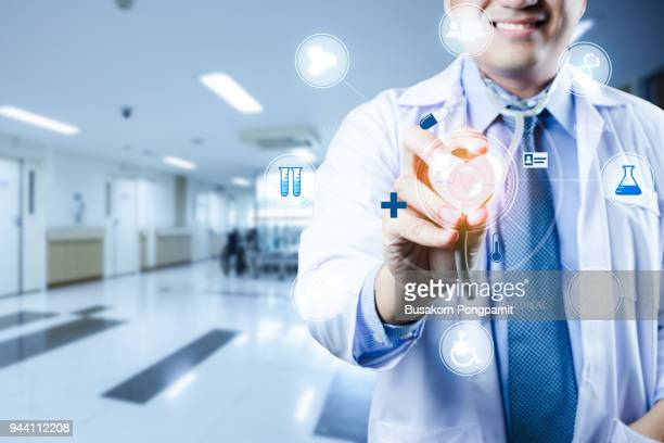 medicine doctor technologies with medical icon at hospital. medical technology network concept - religious service stock pictures, royalty-free photos & images