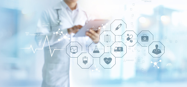 Medicine doctor with stethoscope using tablet and medical icon network connection on virtual screen interface in hospital background. Modern medical technology concept. 1023232666