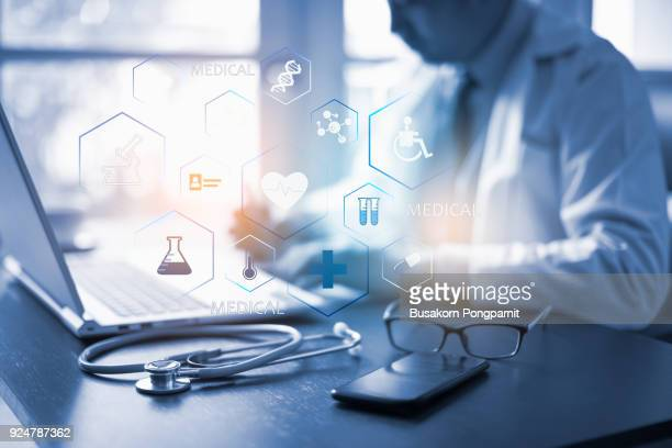Medicine doctor working with laptop and icon medical network connection with modern virtual screen interface, medical technology network concept