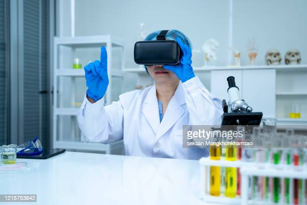 medicine doctor working with vr headset - flying goggles stock pictures, royalty-free photos & images