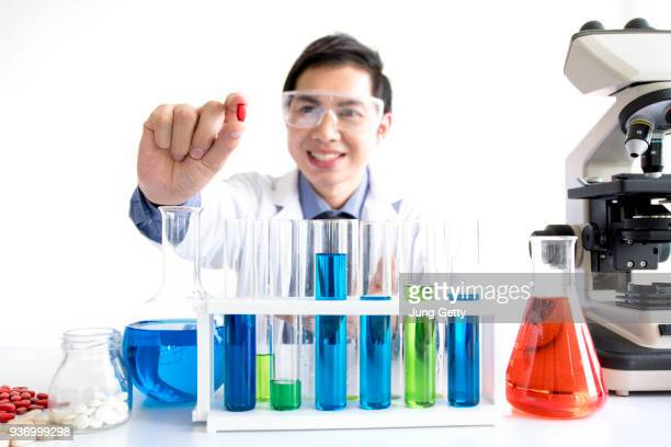 medicine drug researcher working in lab on white background for comercial background - ph value stock photos and pictures