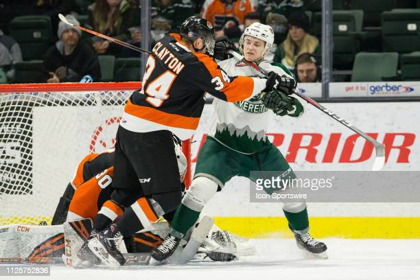 Medicine Hat Tigers defenseman Cole Clayton cross checks Everett Silvertips forward Martin FaskoRudas in the first period of a game between the...