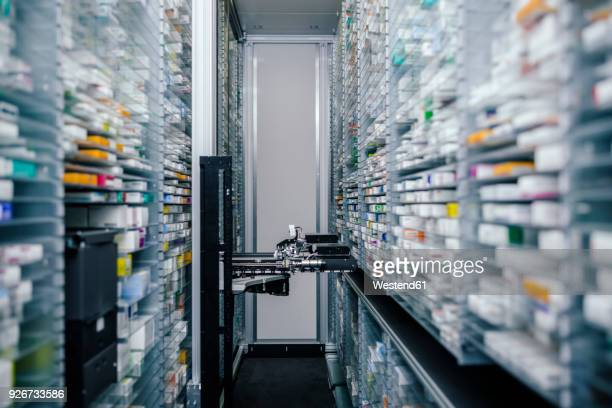 medicine in shelves in commissioning machine in pharmacy - automation stock pictures, royalty-free photos & images