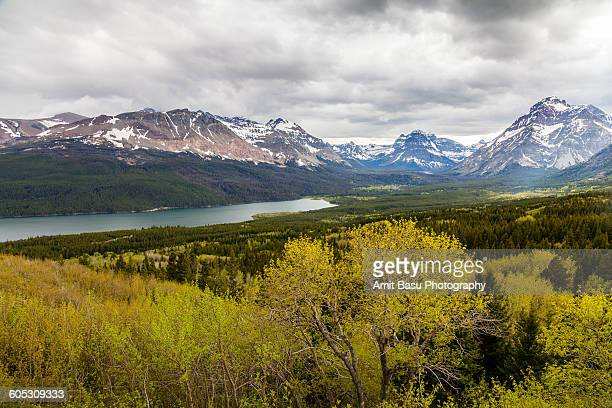medicine lake, glacier national park, montana - two medicine lake montana stock photos and pictures