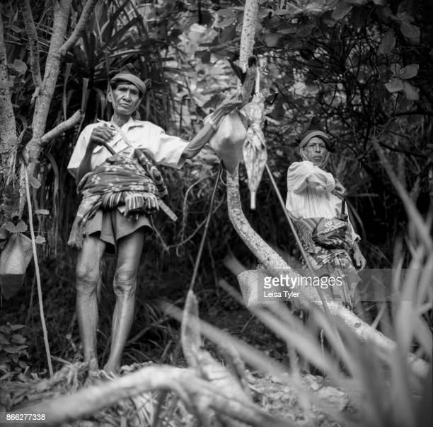 Medicine men await worms to come ashore and herald the beginning of the Pasola horse festival in Sumba Island Indonesia The Pasola is an annual...