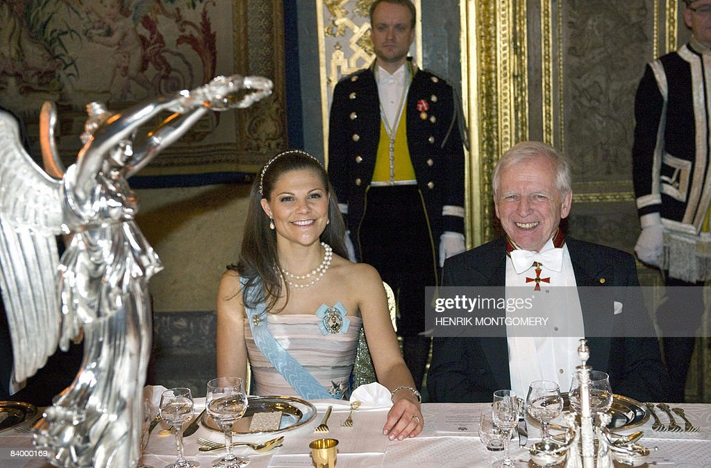 Medicine Nobel prize laureate German Harald zur Hausen (R) sits next to Swedish Crown princess Victoria during the gala dinner at the Royal Palace in Stockholm on December 11 2008. Hausen received his Nobel Prize the day before, December 10.